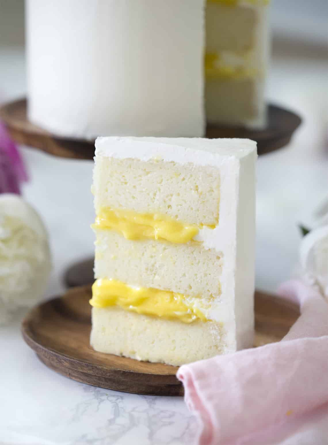 Photo showing a Lemon Elderflower Cake filled with yellow lemon curd