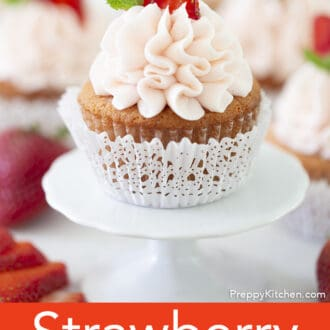 A Strawberry cupcake on a stand.