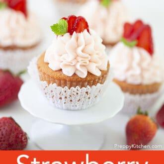 A Strawberry cupcake next to strawberries.