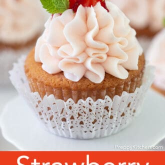 Strawberry cupcakes topped with strawberry slices.