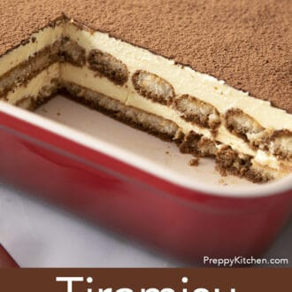 A baking dish of tiramisu with several pieces removed.