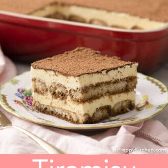 A piece of tiramisu in front of a red baking dish.