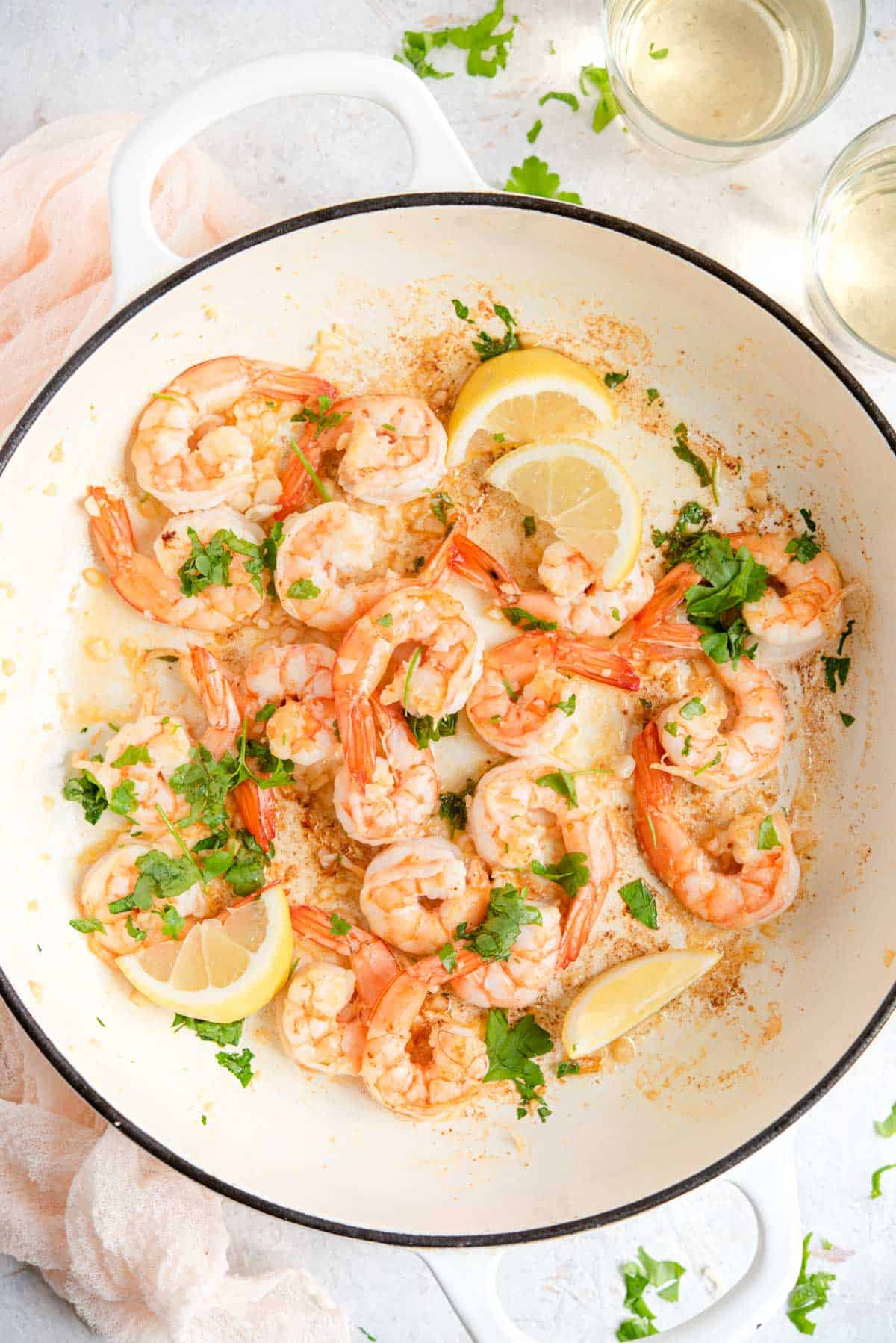 An overhead shot of sauteed shrimp in a large pan