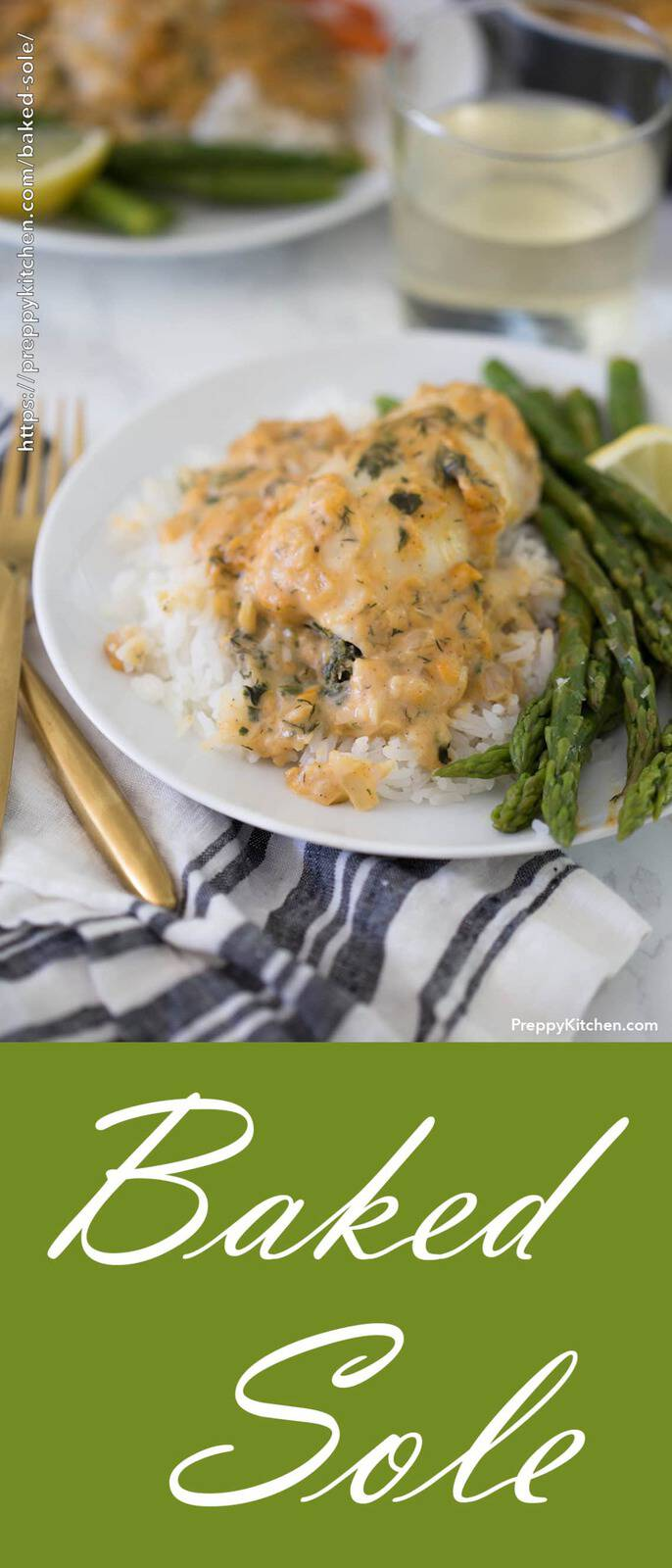 A baked sole fish on a plate with asparagus and white rice