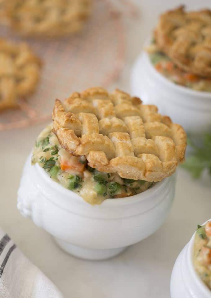 Photo showing chicken pot pies with pastry lattice tops