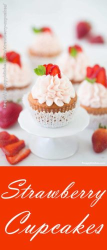 a photo of strawberry cupcakes topped with a fan of three strawberry slices