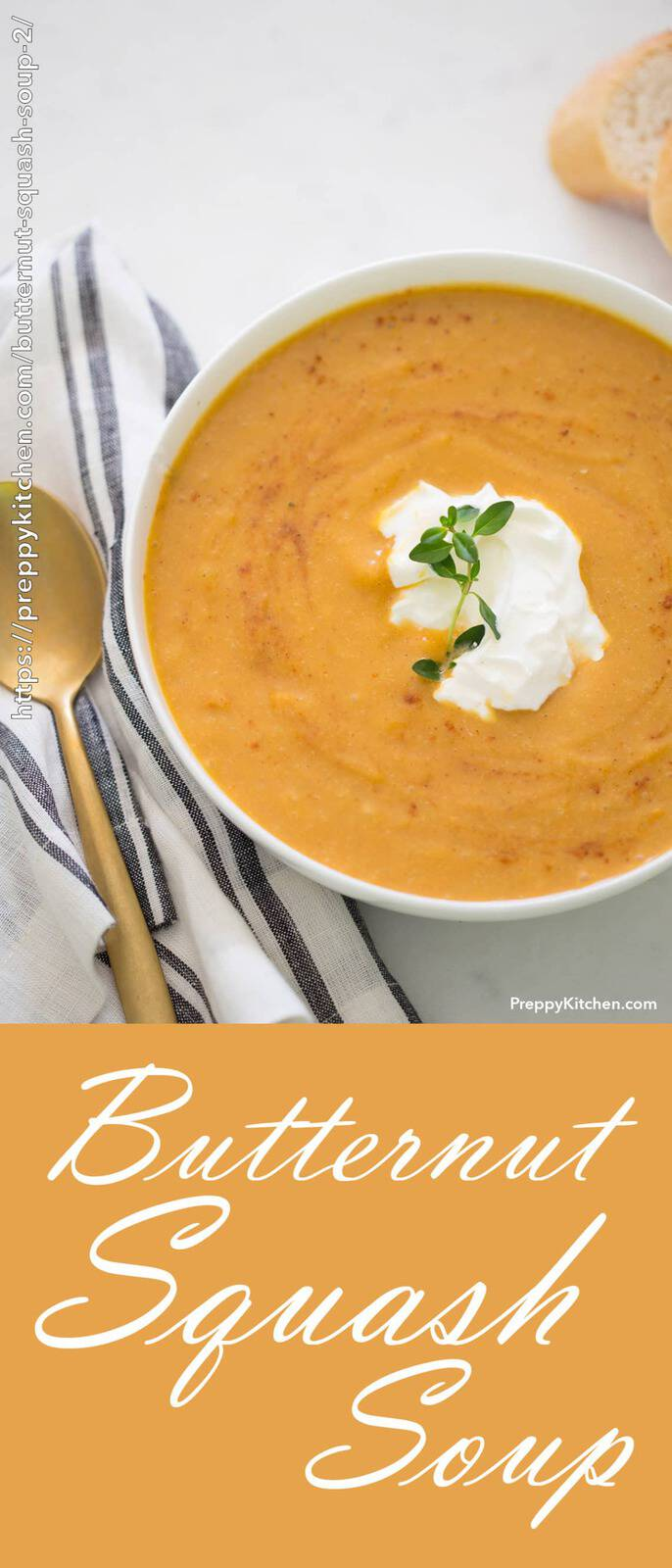 A bowl of butternut squash with a dollop of sour cream and a dash of fresh thyme