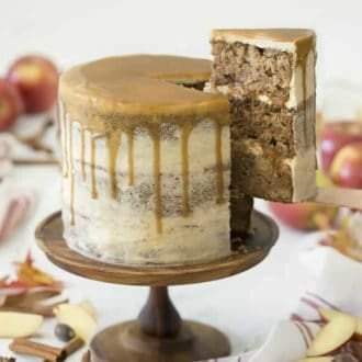 An apple spice cake covered in brown butter frosting and caramel.