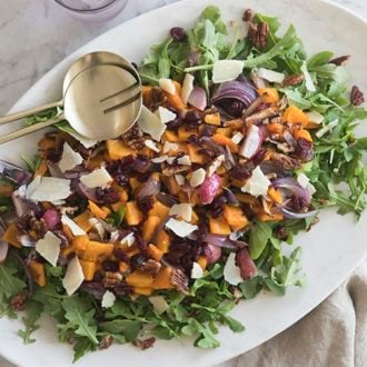 A photo of salad with roasted squash and onions