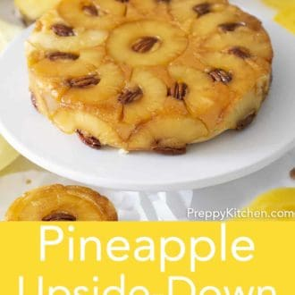 pineapple upside down cake on a cake stand