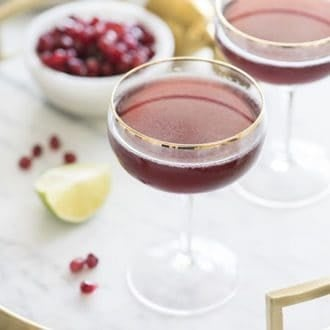 photo of a pomegranate martini on a marble tray