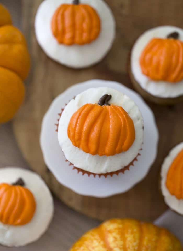photo of pumpkin cupcakes with buttercream pumpkins piped on top