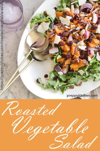 A clipping of a vegetable salad with butternut squash, cranberries, pecans, onions, radishes and cheese
