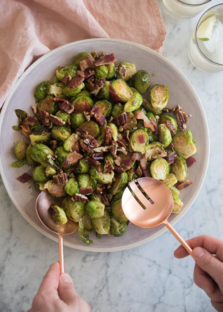 photo of a plate of roasted brussels sprouts being prepared to serve