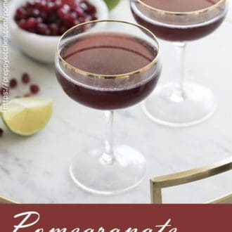 photo of two pomegranate martinis in coupe glasses on a tray