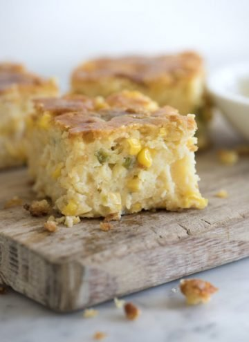 photo of moist jalapeño cornbread pudding on a wooden cutting board