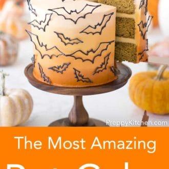 piece of three layered halloween cake with bat decor