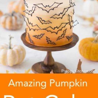 three layered halloween cake with bat decor