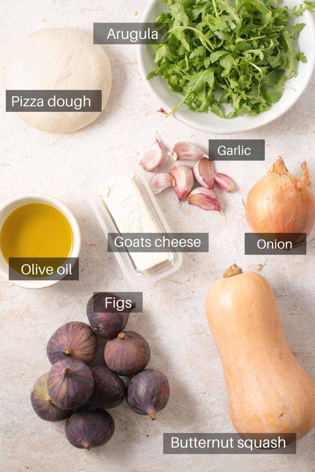 An overhead shot of all the ingredients you need to make a fig pizza
