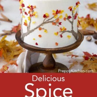 three layered spice cake on a wooden cake stand