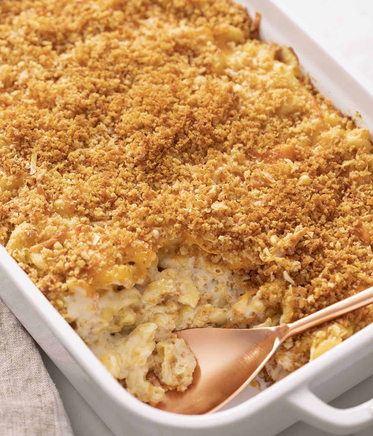 Baked Mac and Cheese in a white baking dish.