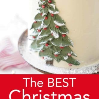 three layer christmas cake with hand painted buttercream christmas tree decoration