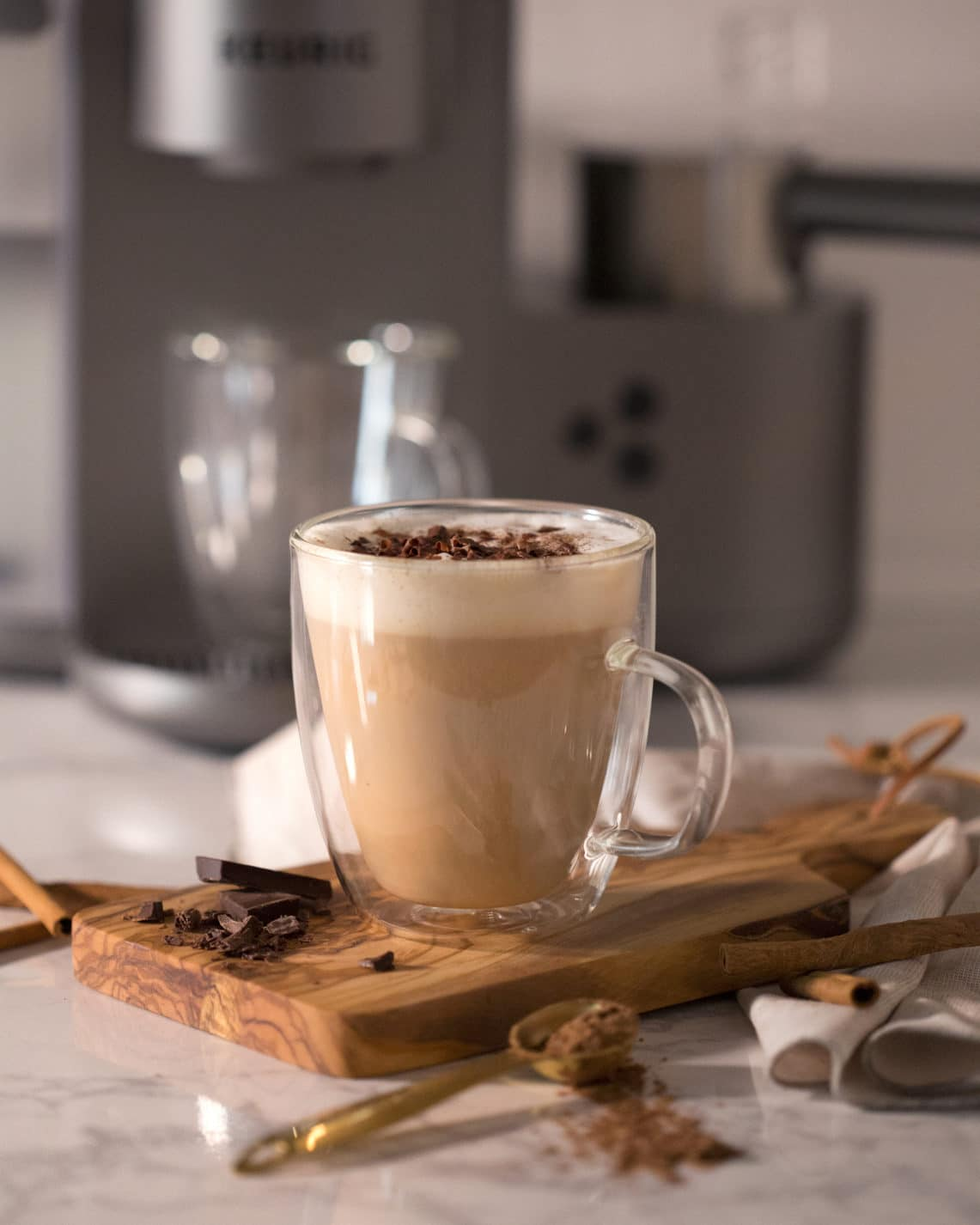 A photo of a Mexican chocolate latte in front of a Keurig