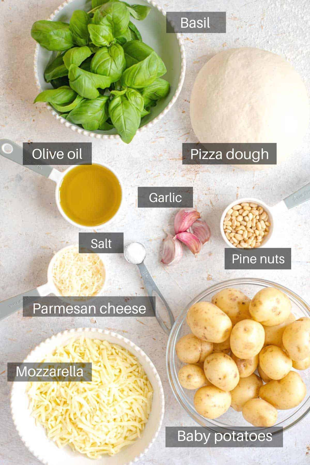An overhead shot showing all the ingredients you need to make potato pizza
