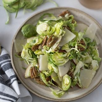 A photo of a shaved Brussel sprouts salad.