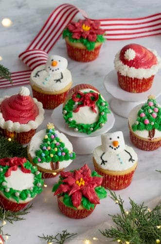 A photo of Christmas cupcakes on a white marble table