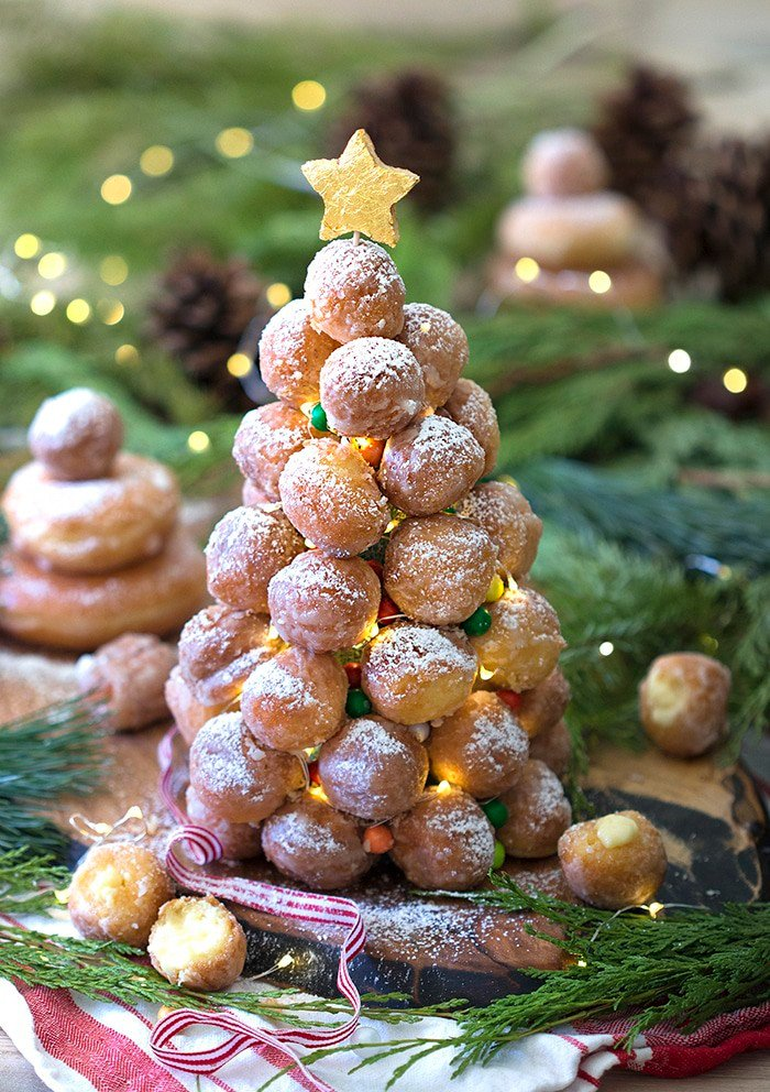 A photo showing a crquembouche made from donut holes with LED mini lights