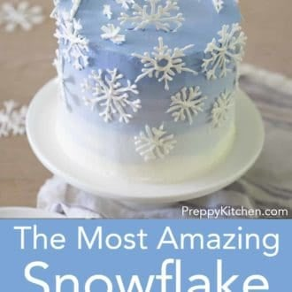 snowflake layer cake on a stand