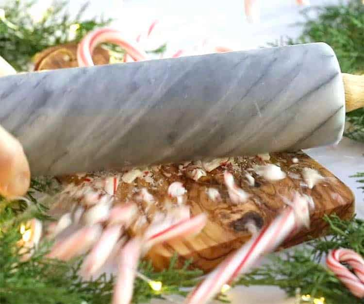 Candy canes being crushed with a marble rolling pin.