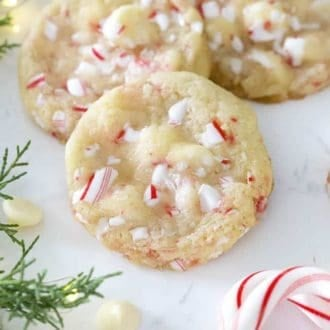 White chocolate peppermint cookies on a marble surface.