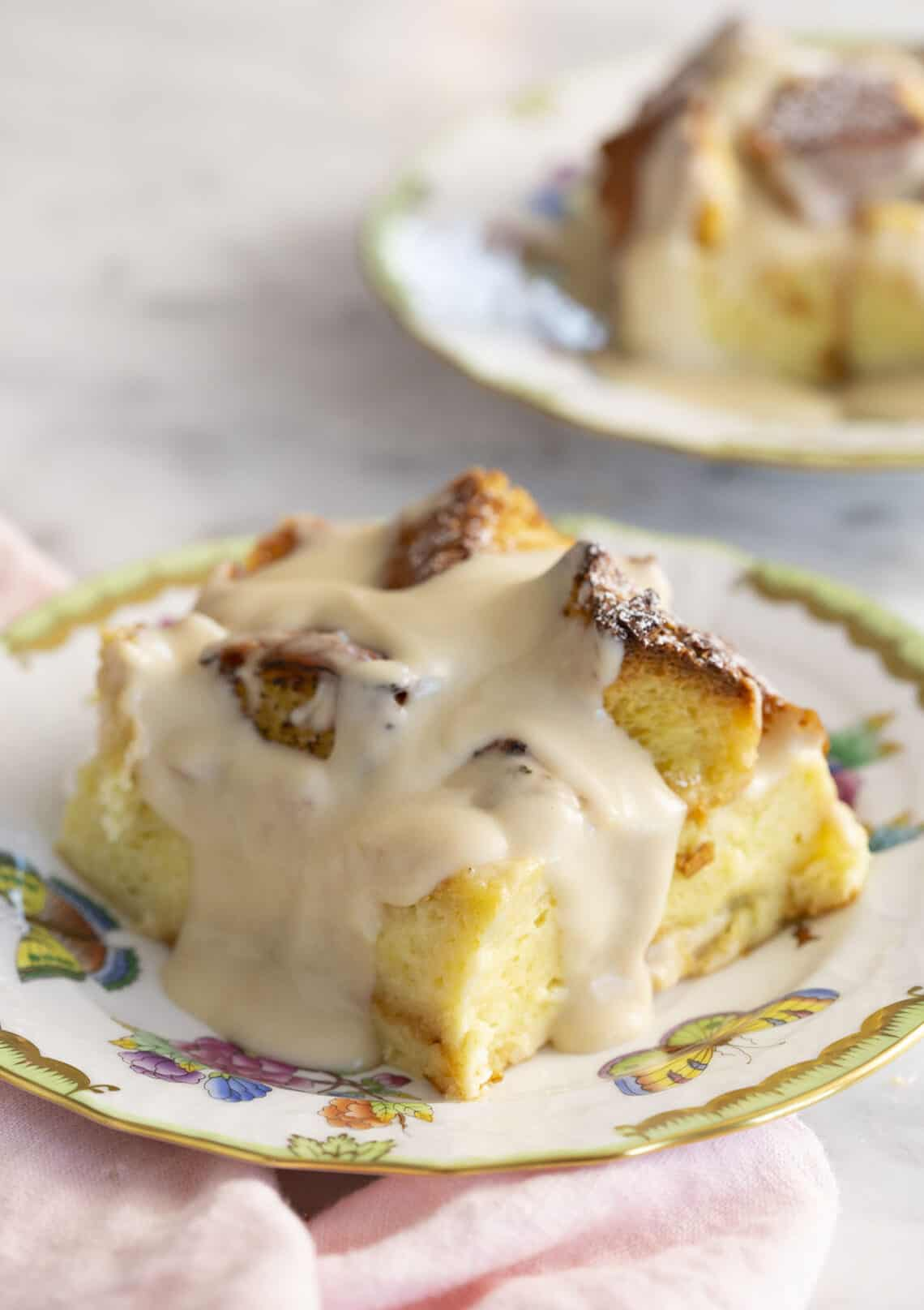 Pieces of bread pudding covered in a rum sauce.