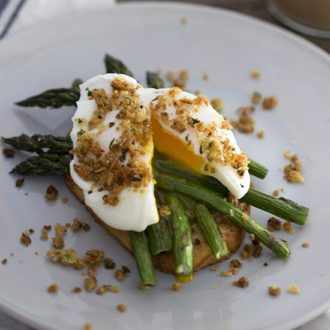 A photo of a poached egg on asparagus and toast