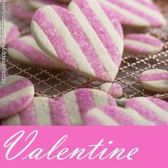 a photo for pinterest of pink and white heart-shaped valentine cookies.