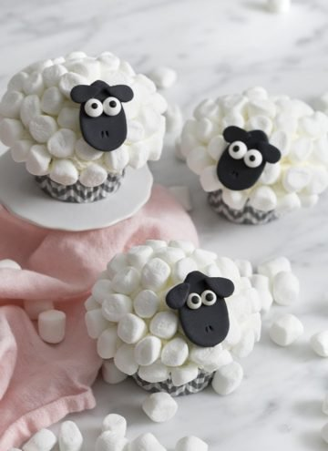 A photo showing a group of sheep cupcakes with mini marshmallow fur.