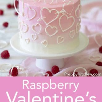 valentines day cake with white hearts on a stand