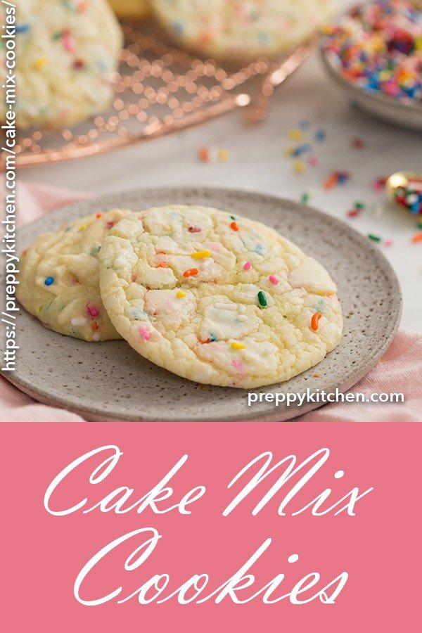 A clipping of a couple cake mix cookies embedded with rainbow sprinkles.