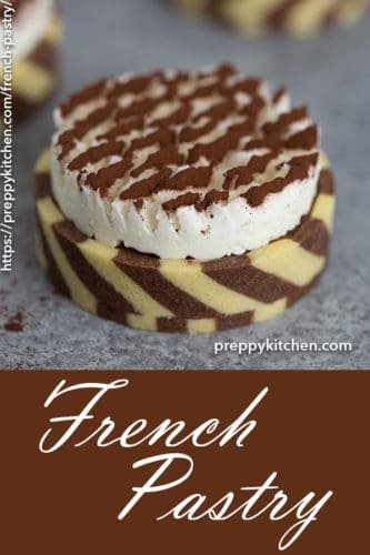 A clipping showing a french pastry with a Swiss meringue topping dusted with cocoa powder.
