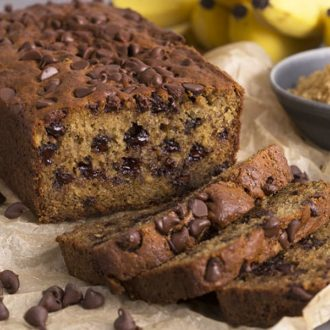 A closeup photo of a loaf of Chocolate chip banana bread showing the melted chocolate chips inside.
