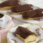 A photo of a chocolate eclair cut to expose the custard filling
