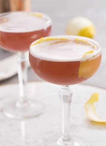 A photo of two french martinis on a marble tray