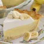 a piece of banana cream pie with banana slices scattered around