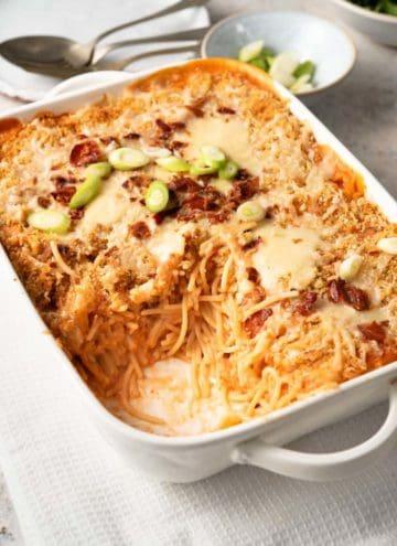 Cheesy chicken spaghetti in a casserole dish