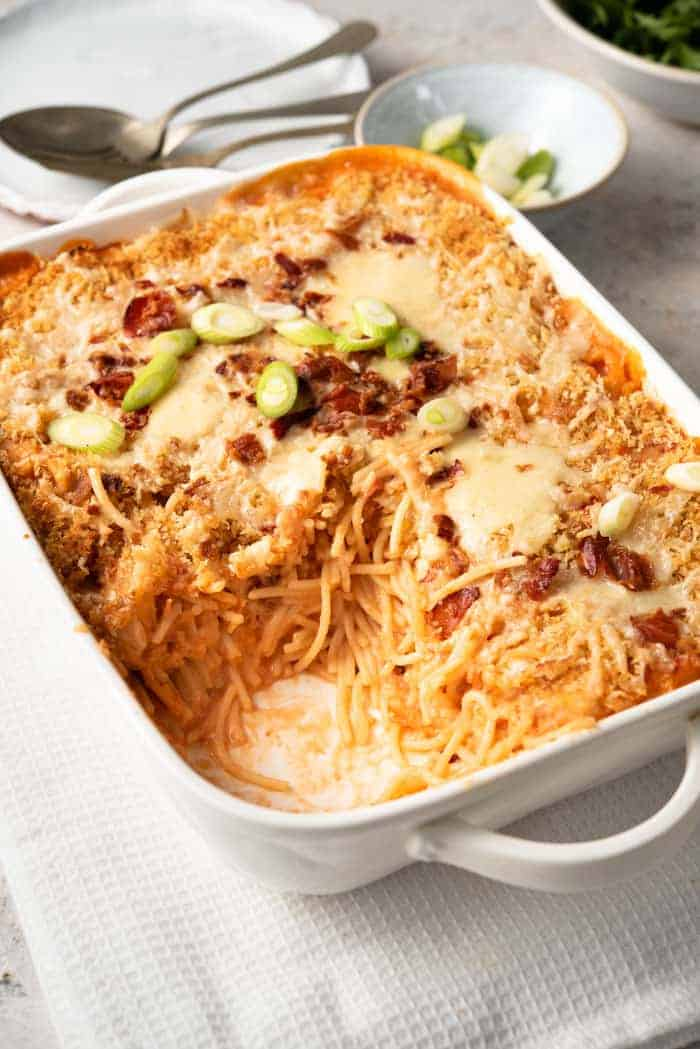 Cheesy chicken spaghetti in a casserole dish