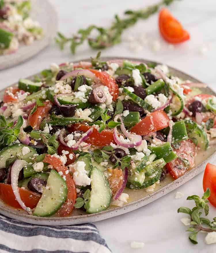 A large Greek salad on a white platter