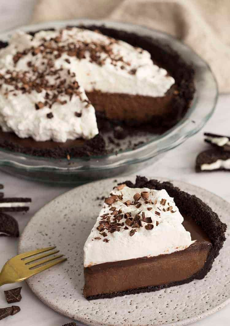 a piece of mud pie topped with whipped cream