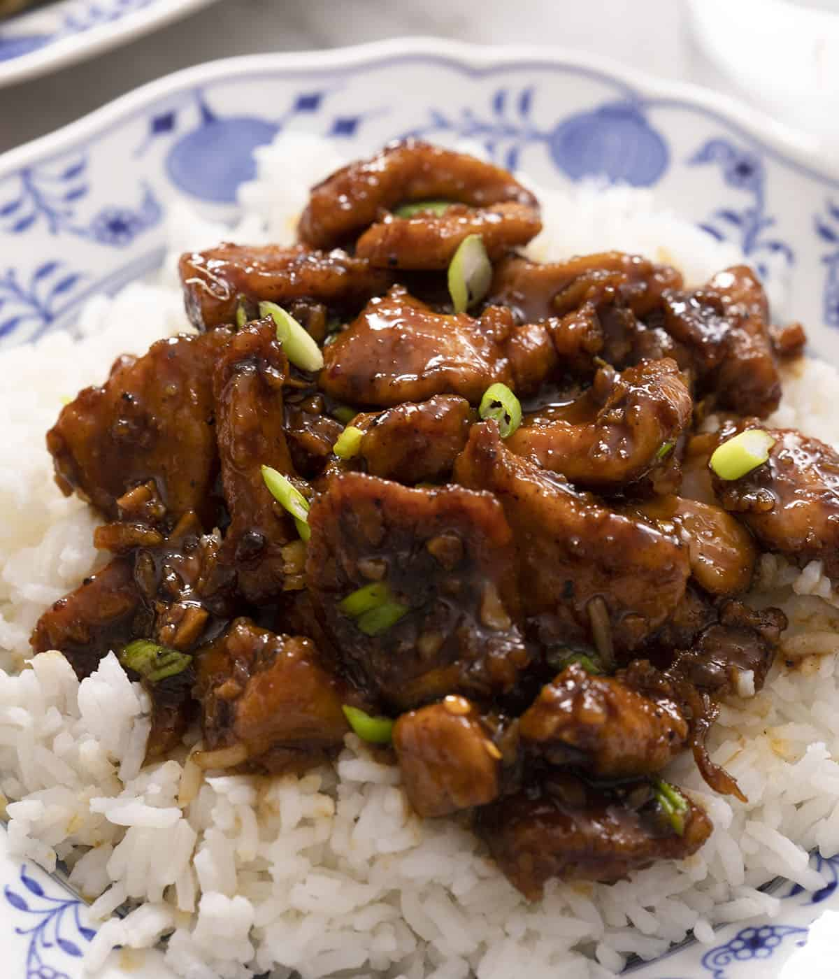 A close up of Bourbon Chicken on top of rice